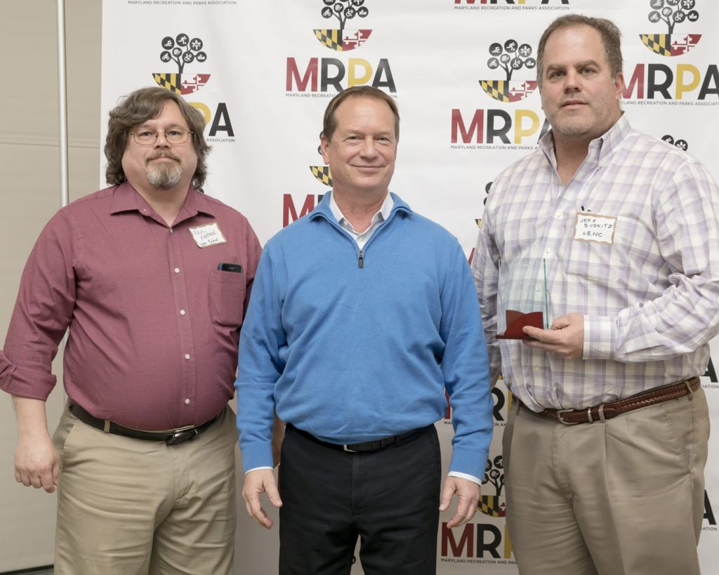 Jeffrey Budnitz (right), Nature Council Treasurer and Trails Committee Chair and Paul Hartman (left), President of The Computer Engineering Group, Inc. being awarded the Maryland Recreations and Parks Best Website Award by MRPA President Tim Chesnutt (center)